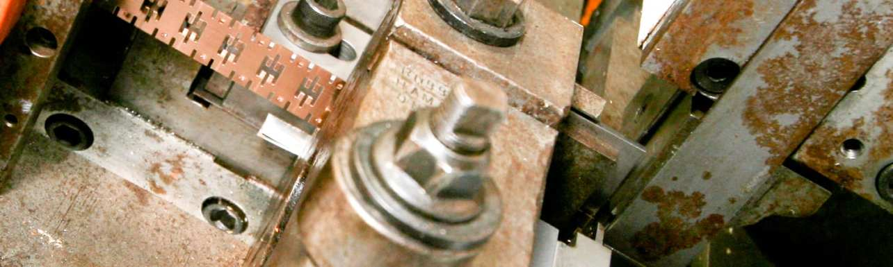 Custom metal stampings for various parts and materials.