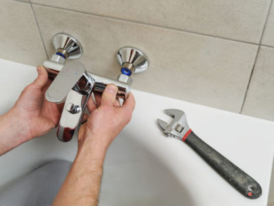 plumber in Loveland, CO installs a bathtub spigot