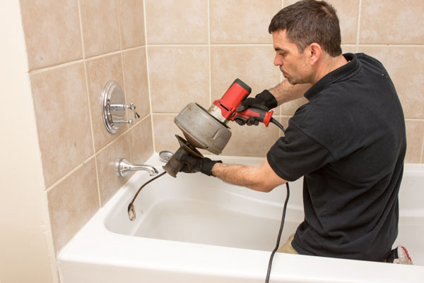 Relief Home Services clearing drain clog during a plumbing service visit in Boulder, CO.
