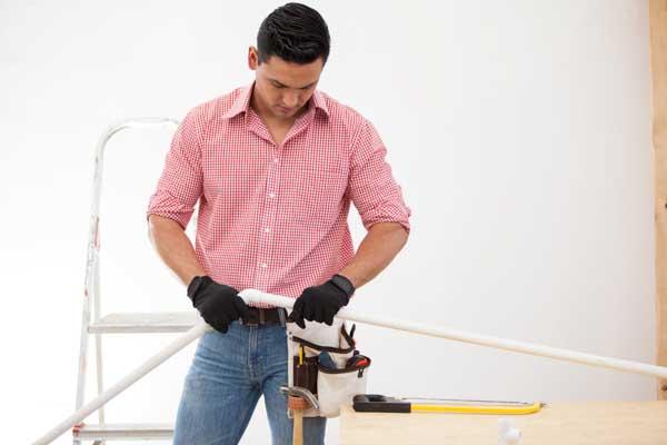 Relief Home Plumbing technician repairing drain line in Fort Collins, CO.