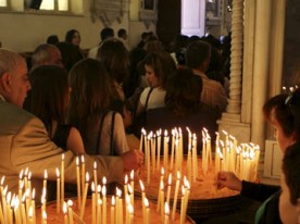 Syrian Catholics light candles as they celebrate the resurrection of Jesus Christ