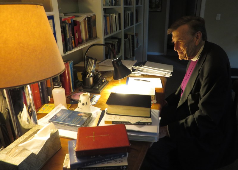 John Shelby Spong sits at his desk at his New Jersey home on Sept. 12, 2013. The liberal churchman writes longhand with a fountain pen on yellow legal pads. RNS photo by David Gibson