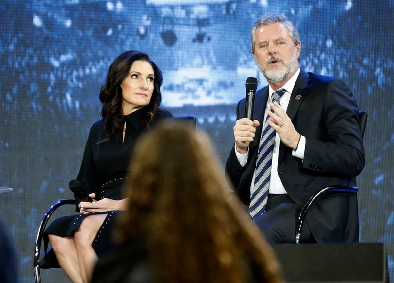 Jerry Falwell Jr., right, answers a student's question, along with his wife, Becki, during a town hall on the opioid crisis at a convocation at Liberty University in Lynchburg, Virginia, on Nov. 28, 2018. (AP Photo/Steve Helber)