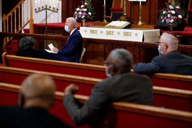 In this Monday, June 1, 2020, file photo, Democratic presidential candidate former Vice President Joe Biden listens as clergy members and community activists speak during a visit to Bethel AME Church in Wilmington, Delaware. Democrats are betting on Biden's evident comfort with faith as a powerful point of contrast in his battle against President Donald Trump. (AP Photo/Andrew Harnik, File)