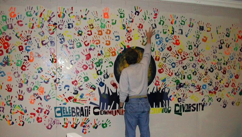 Bernard Brandon Scott adds his handprint to the Companion Wall at the Community of Hope Church in Tulsa, Oklahoma. Photo courtesy of Leslie Penrose