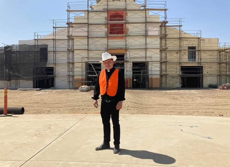 The Rev. Alex Chavez in front of the St. Charles Borromeo Catholic Church construction site in Visalia, California, Thursday, Aug. 26, 2021. RNS photo by Alejandra Molina