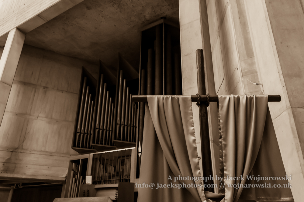 Clifton Cathedral cross and church organs, Bristol, England, UK, sepia tone