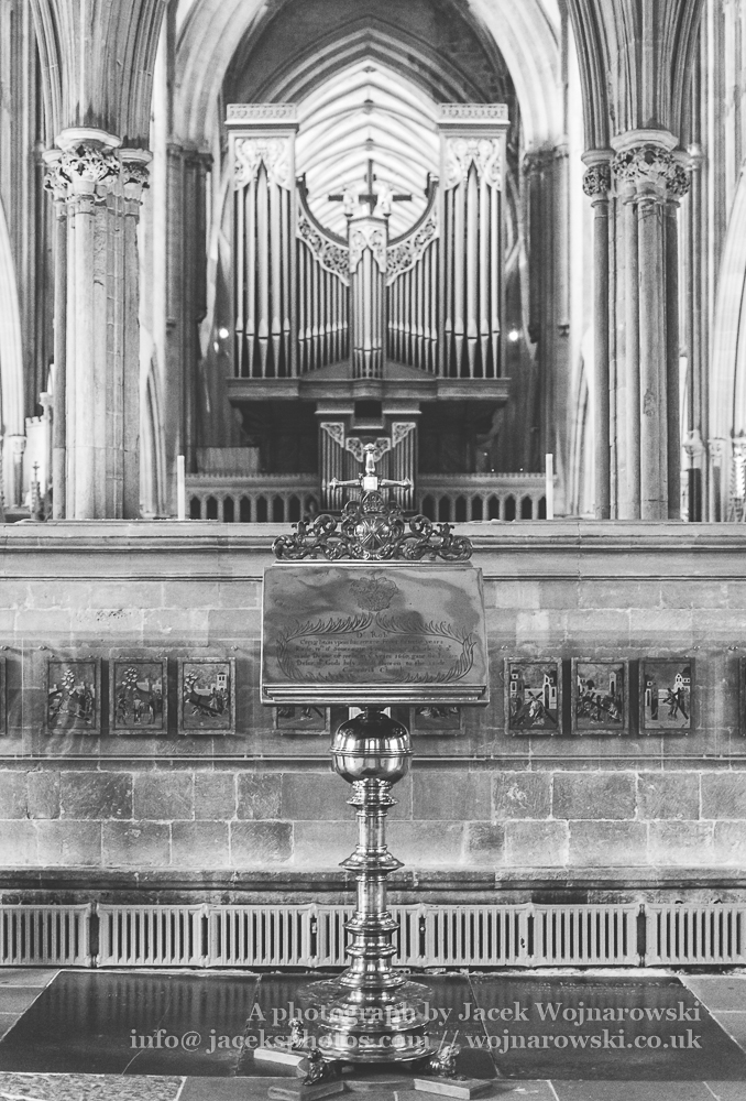 Brass Lectern with blurred Organ in Wells Cathedral BW