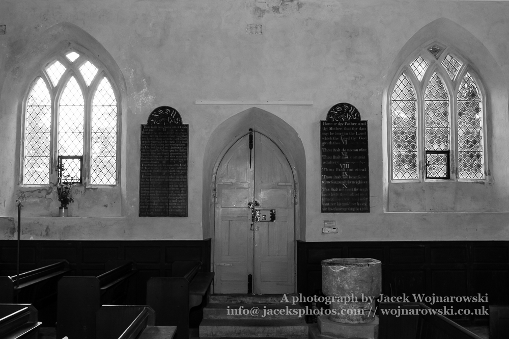 Inside Main Door of The Blessed Virgin Mary in Somerset black and white, England is medieval in origin but underwent extensive renovation in the 18th century