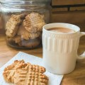 A cup of tea with peanut butter cookies