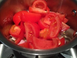 Toss the tomatoes in the pan!
