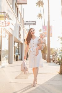 Blogger, RELish By Arielle wears a dress with buttons down the middle by Mango