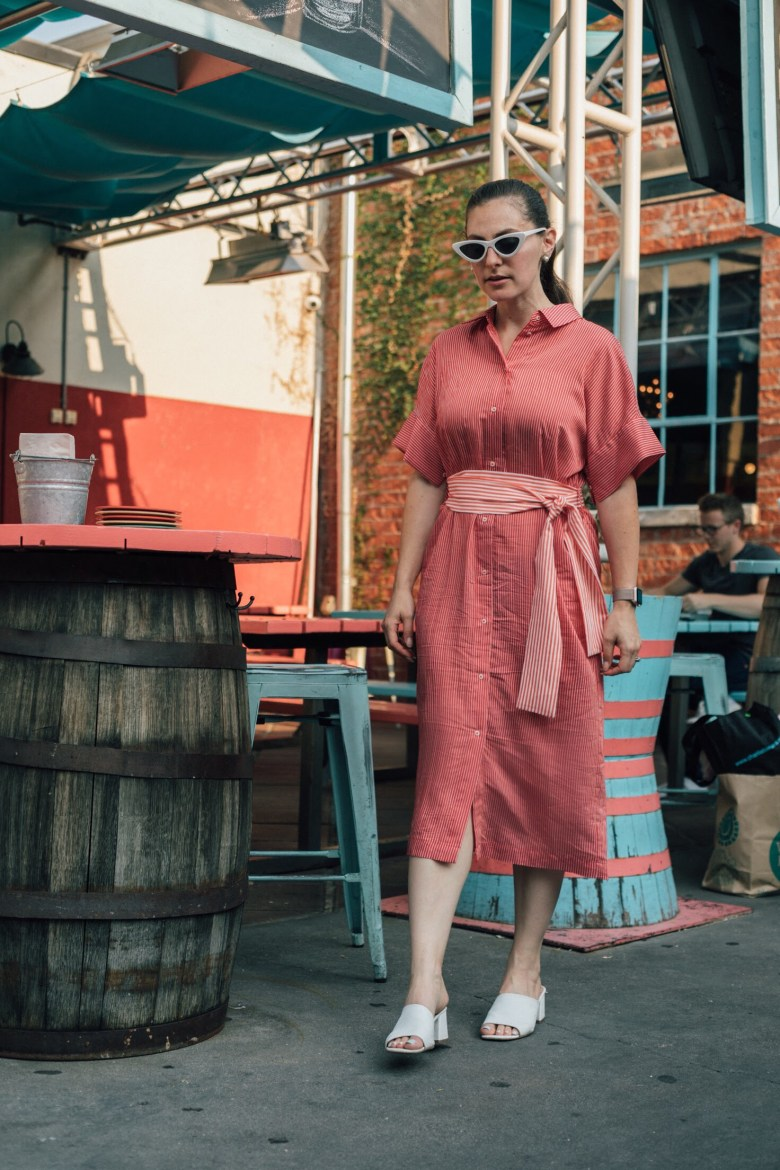 Los Angeles mom blogger, RELish By Arielle, wears a red midi dress