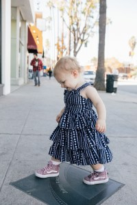 Los Angeles blogger, RELish By Arielle's daughter wears a navy blue tiered dress