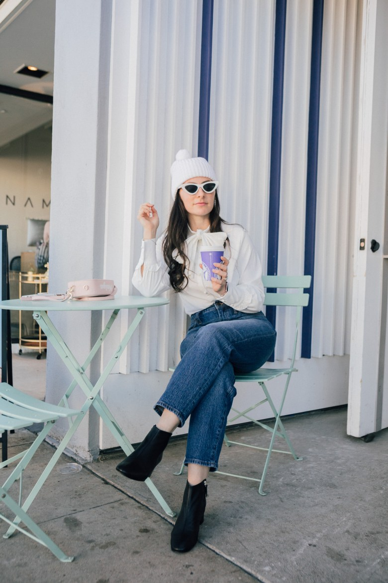 LA blogger, RELish By Arielle, wears a black booties and a white hat by Everlane