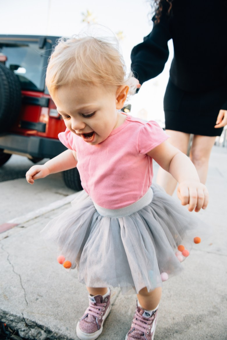 LA blogger, RELish By Arielle's daughter wears a pom pom tutu from Amazon