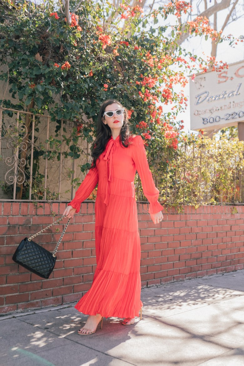 Los Angeles style blogger, RELIsh By Arielle, wears a red maxi dress with a bow in front from Zara