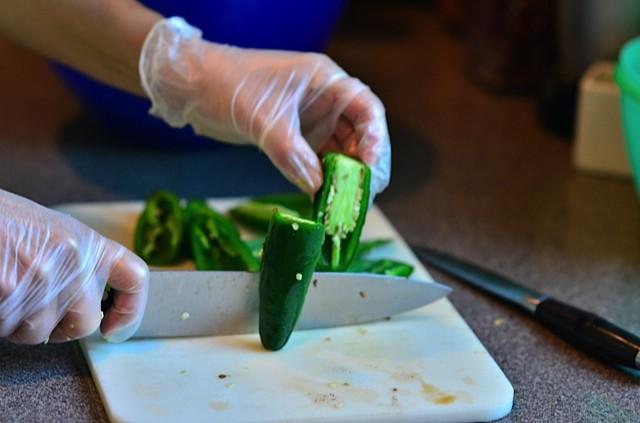 cutting a jalapeño pepper