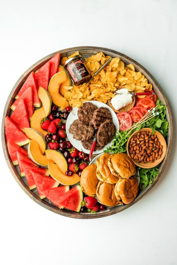 round burger board with patties in the center