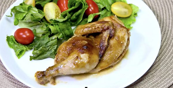 a half cornish game hen served with salad