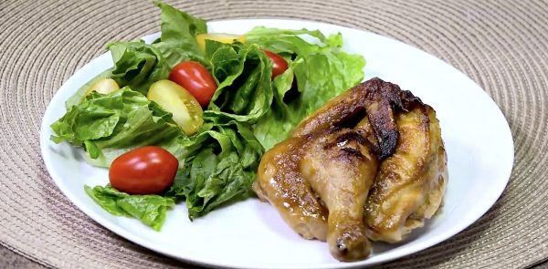 baked cornish game hen served with salad