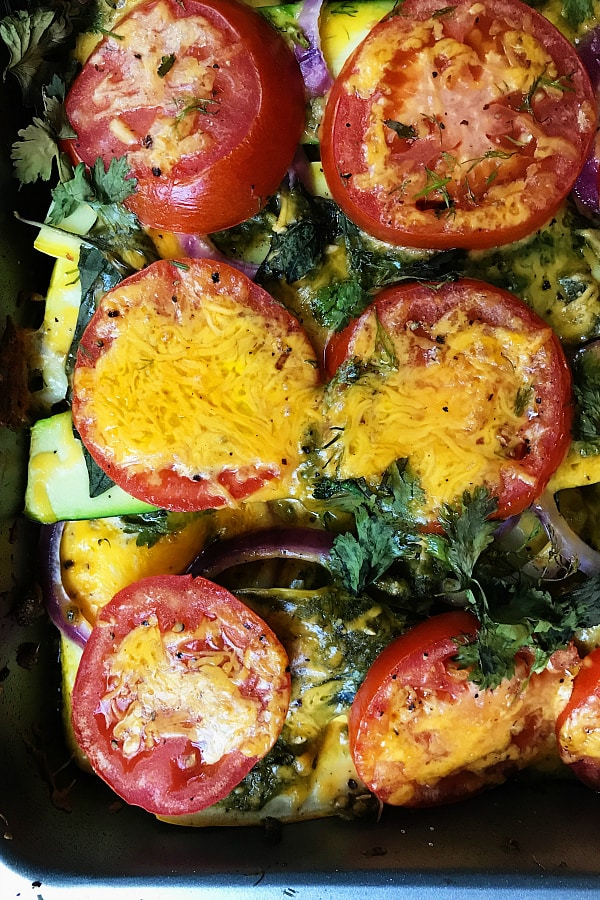 melted cheese on tomatoes on Summer Squash Casserole