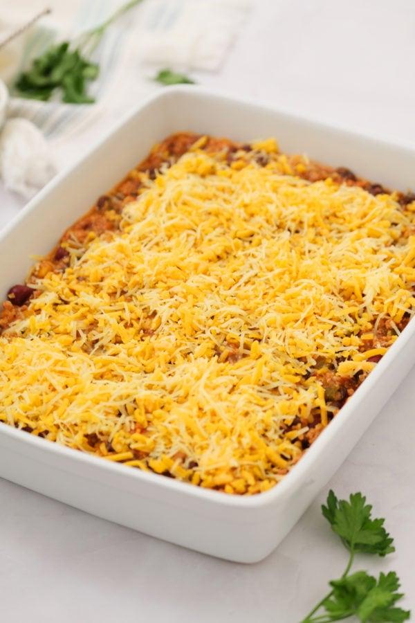 adding cheese to chili pot pie