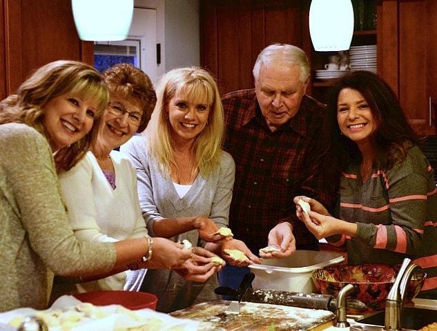 family making Fleischkuekle Recipe | ReluctantEntertainer.com