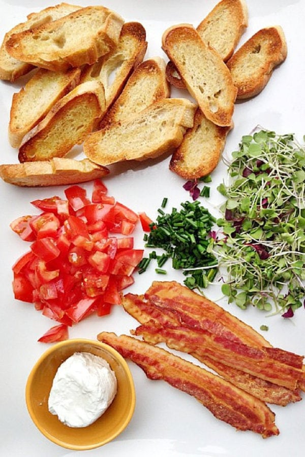 bacon, tomatoes, goat cheese, toasts, micro greens