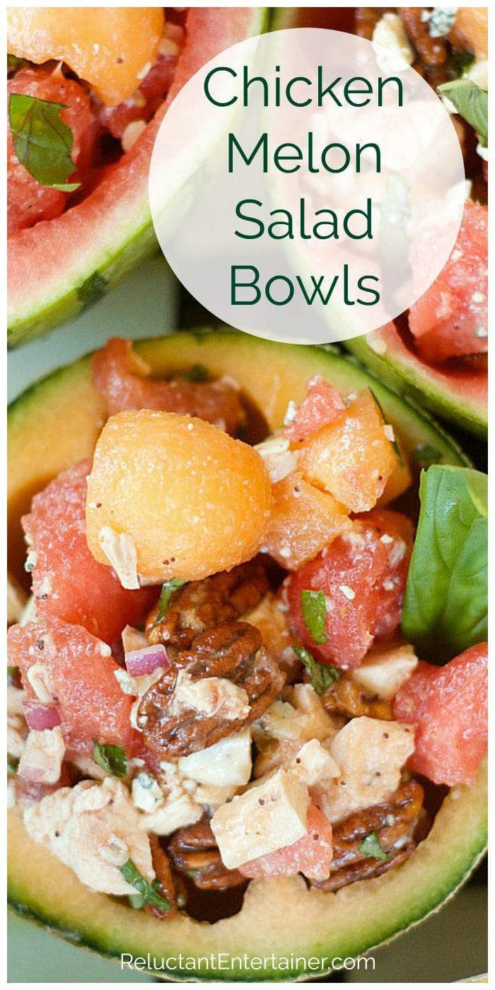 cantaloupe scooped out into a bowl filled with melon balls, chicken, pecans, and basil
