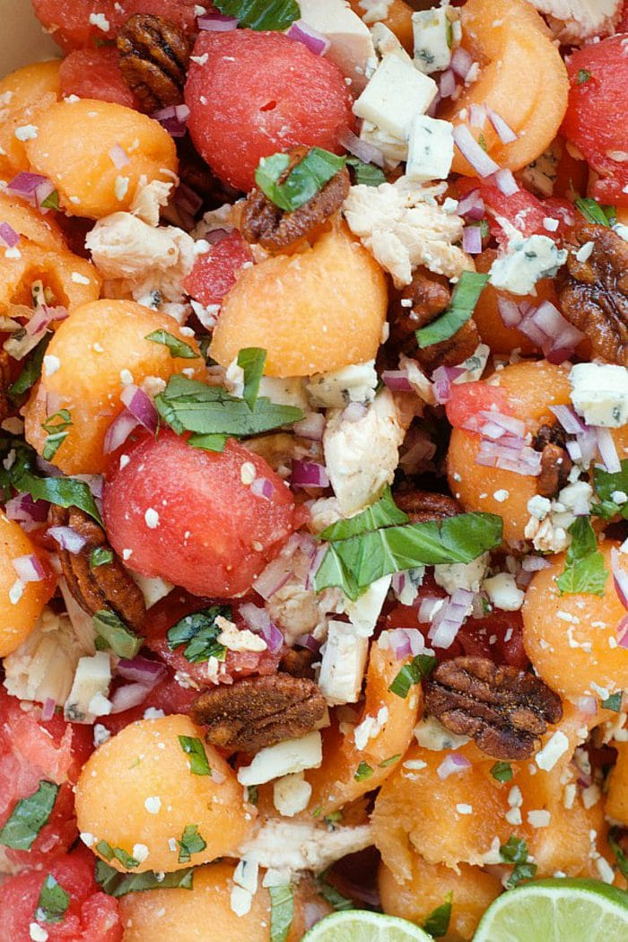 mixture of melon balls with chicken, pecans, dressingm and basil