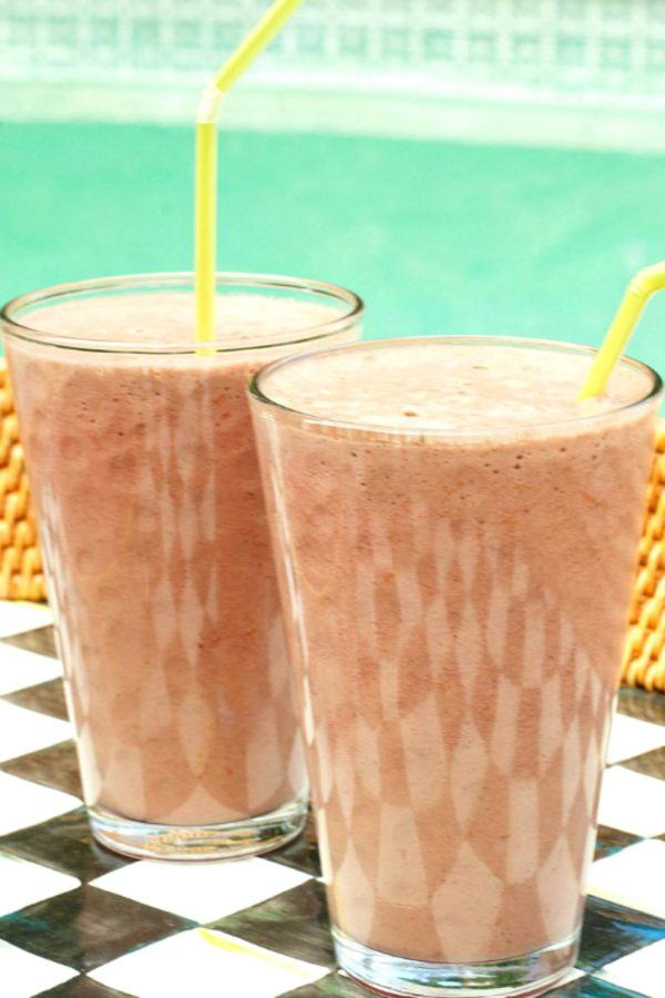 2 glasses of raspberry smoothies with yellow straws