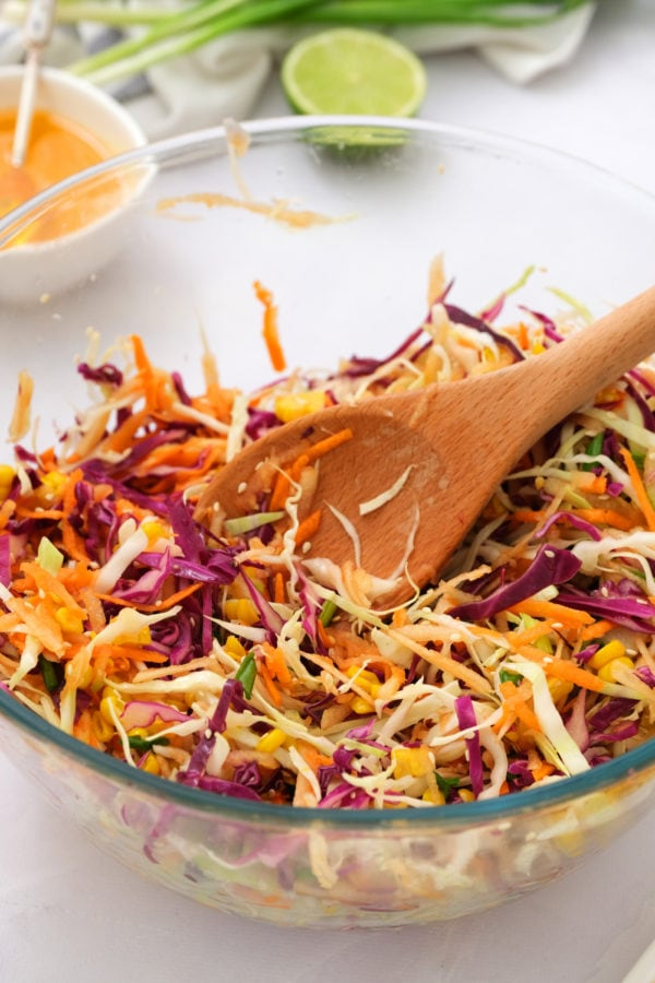 stirring Sweet Asian Slaw with Apple and Corn