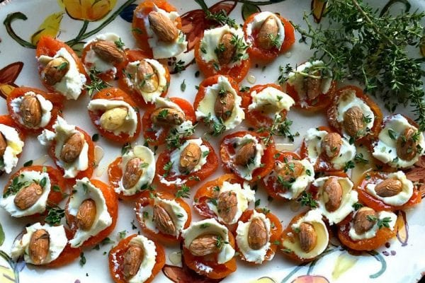 plate of dried apricot bites with goat cheese