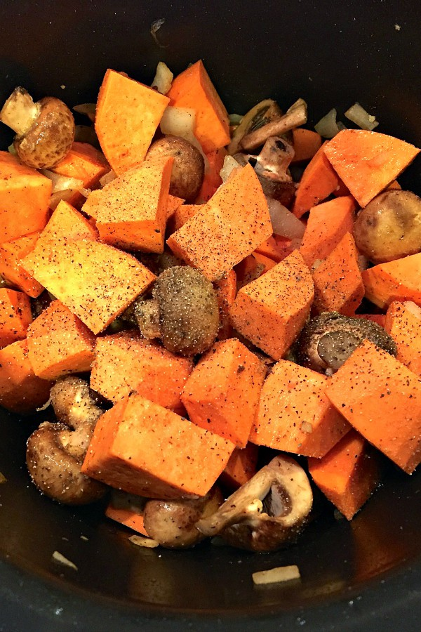 making a pot of chicken with sweet potatoes and mushrooms