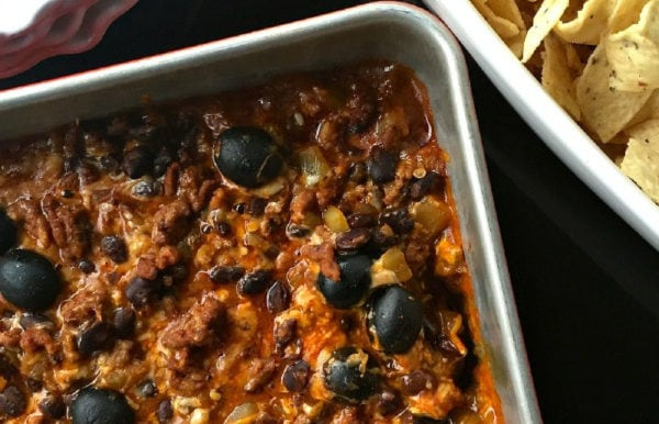 pan of Cheesy Enchilada Dip with olives
