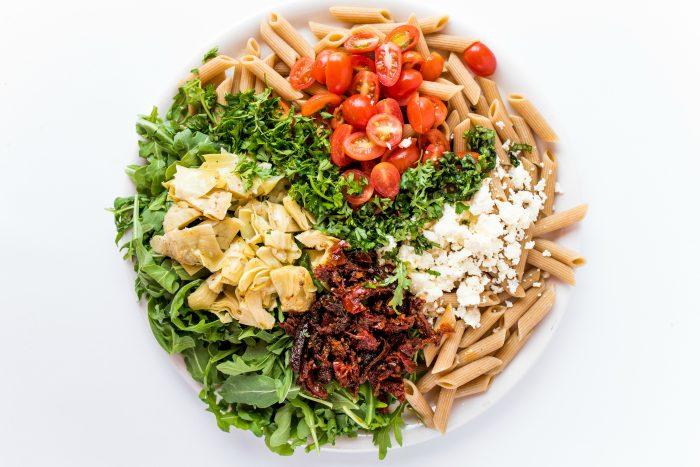 arugula salad ingredients on a plate