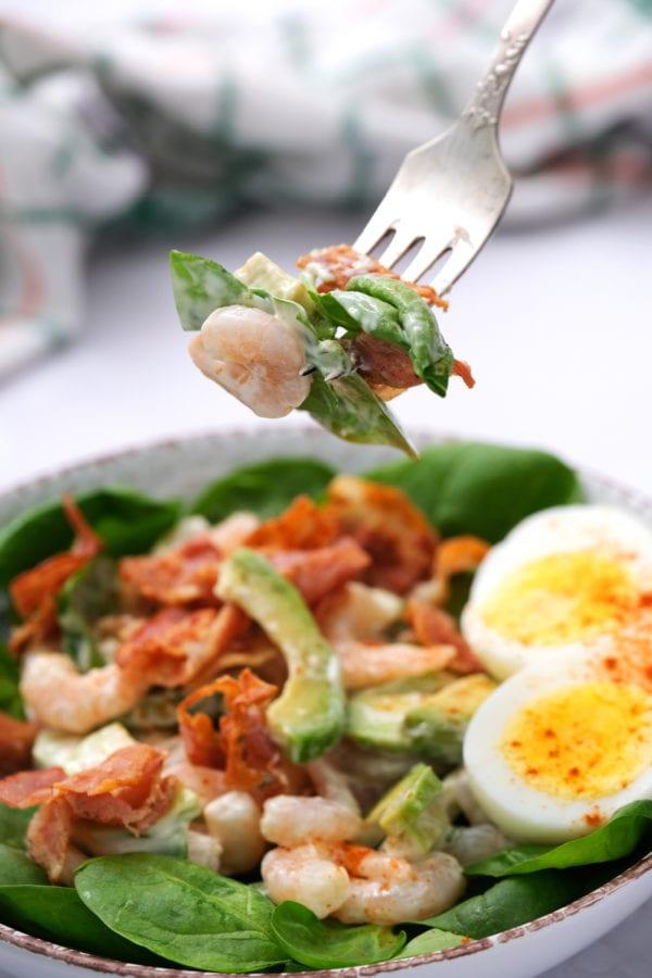 bite of Green Salad with Shrimp and Avocado