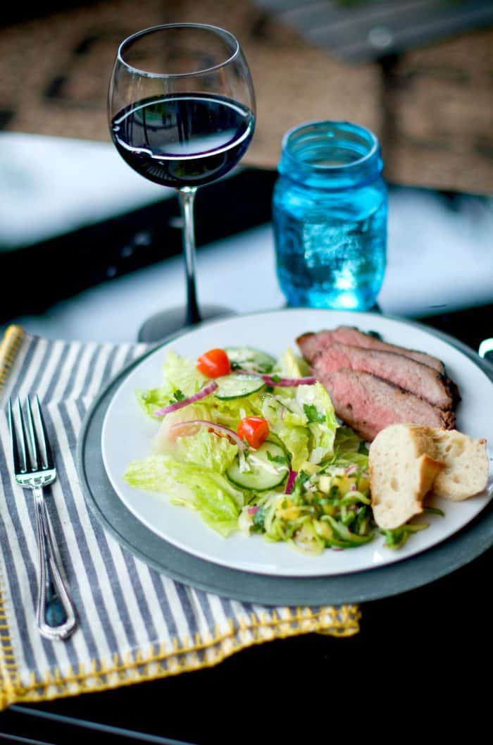 a beautiful plate of Grilled Garlic Pepper Tri Tip with salad and bread