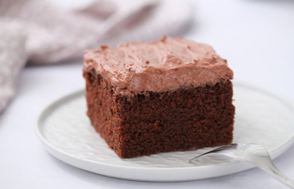 square piece of chocolate cake with buttermilk frosting