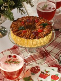 Collin Street Bakery Deluxe® Fruitcake is festive, and delicious served with a Cranberry Kir Royale holiday drink
