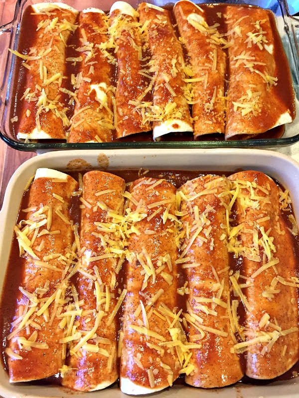 making and rolling up Cheesy Meat Enchiladas with homemade sauce