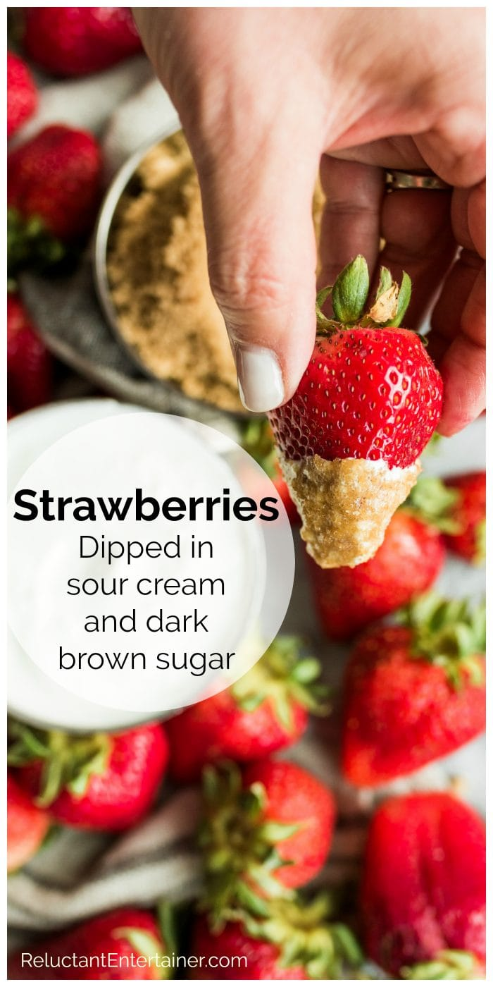 a giant strawberry dipped in sour cream and dark brown sugar