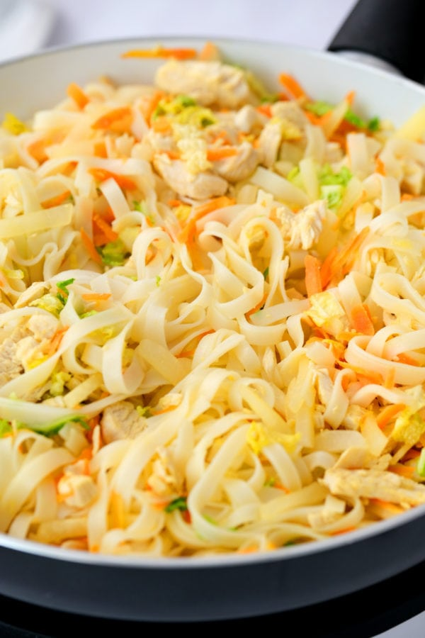 mixing in a bowl Easy Pad Thai Salad