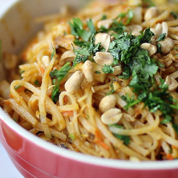 Peanuts and cilantro on top of a bowl of Spicy Easy Pad Thai Salad Recipe