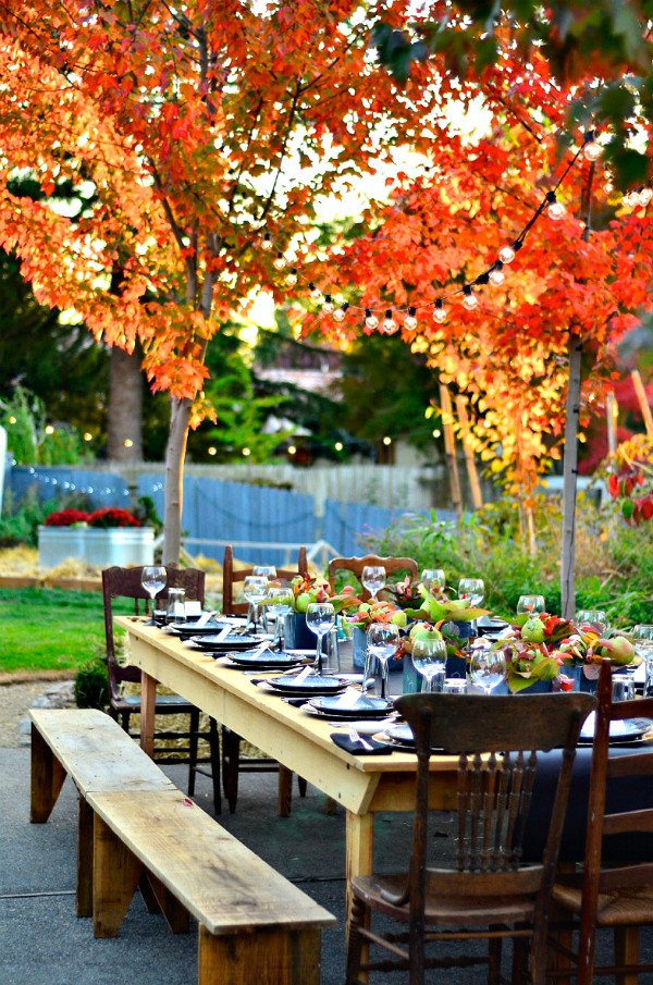 fall tablescape decorated with pears (setting for 14)