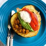 stuffed acorn squash with chickpeas, veggies, tahini