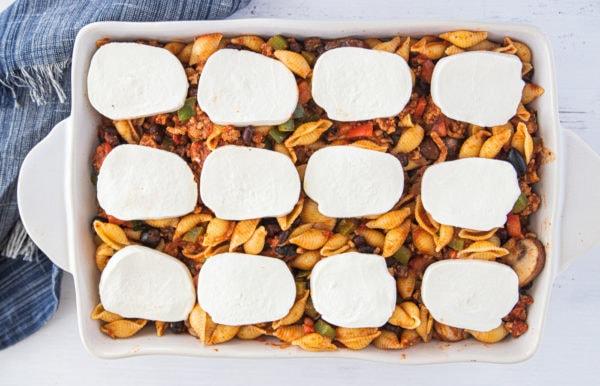 preparing Mexican Ground Turkey Olive Pasta Bake