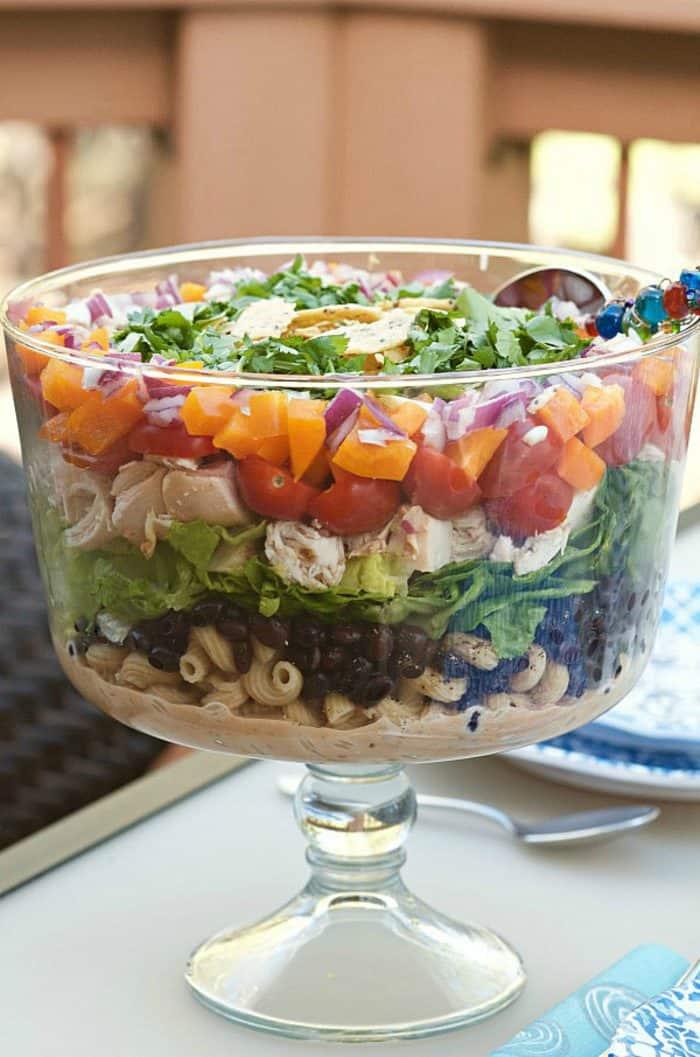 a parfait bowl of chicken pasta salad