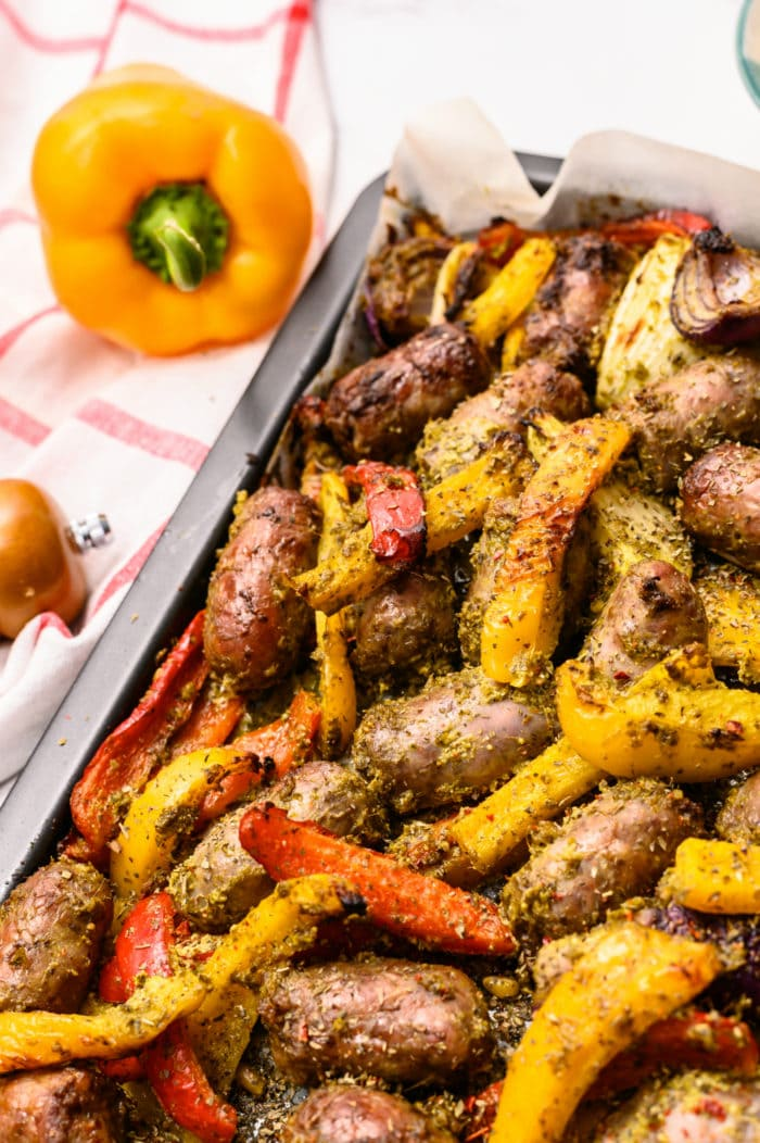 brats and peppers on sheet pan